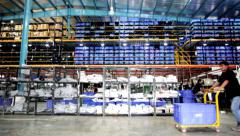 Man Working at an E-commerce WareHouse Pulling a Trolley Pallet Stock Footage