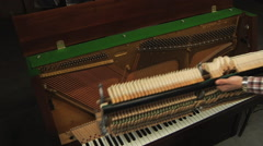 Piano restoration in the workshop - stock footage