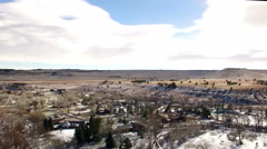 Aerial drone fly over small western plains winter snow community town. - stock footage