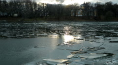 Pond with ice formed in December and solar flare - stock footage