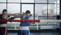 Two young professional boxers are fighting on the boxing ring - stock footage