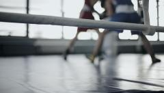 Two young professional boxers are fighting on the boxing ring. Defocused Stock Footage
