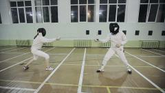 Two young women fencers on a training. Slow motion Stock Footage
