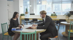 Business Partners at the meeting. Lady discusses strategy with a man. Stock Footage