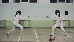 Two young women fencers on a training Stock Footage
