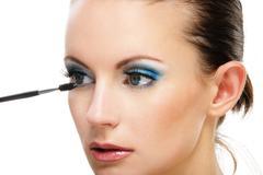 Woman applying blusher eyelid - stock photo
