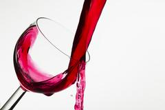 Wine pouring into a glass - stock photo
