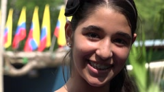 Teen Girl Posing with Colombian Flags Stock Footage