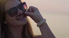 Funny Teen Girl Poses With A Piece Of Seaweed, She Pretends To Have A Mustache Stock Footage