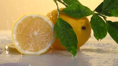 Fresh lemon pour water.  Slow motion 240 fps. - stock footage