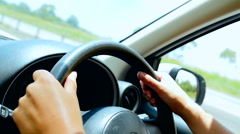Close up of womans hands driving Stock Footage