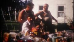 2865 - summer family picnic at the farmhouse - vintage film home movie Stock Footage