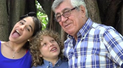 Grandfather and Grand Kids Having Fun Stock Footage