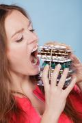 Woman taking eating pills tablets. Drug addict. Stock Photos