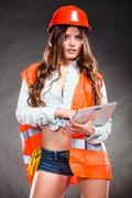 Woman structural engineer with tablet working. - stock photo