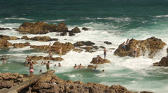 "High tide diving at ""The Point"" Mossel Bay, SA. - stock footage"