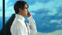 Business traveler talking on phone - stock footage