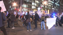 Activists protest the T.P.P. and block traffic in Washington.   Stock Footage