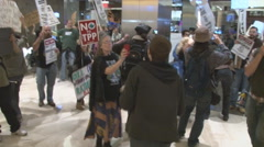 Activists protest the T.P.P. inside a corporate office in Washington.   Stock Footage