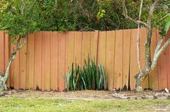 old stockade fence - stock photo