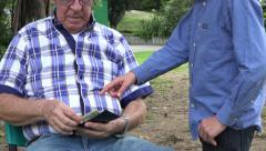 Grandfather Giving Money to Grand Kids Stock Footage