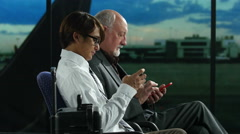 Business travelers texting wide Stock Footage