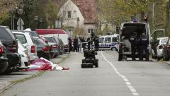 French police operating a bomb disposal robot in action Stock Footage