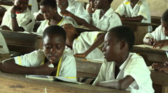 STUDENTS READING IN ADEISO CLASSROOM Stock Footage