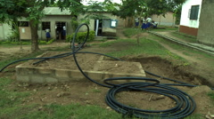 HOSE ON CONCRETE SLAB AT ADEISO SCHOOL Stock Footage