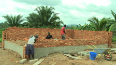 ADEISO MEN BUILDING SANITATION FACILITY - stock footage