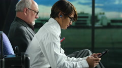 Airline Passengers with tablet, smartphone Stock Footage