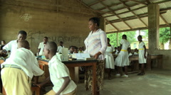 ADEISO WIDE ON TEACHER AND STUDENTS IN CLASSROOM Stock Footage