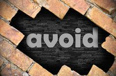 Stock Photo of Hole in the brick wall with word avoid