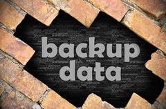 Hole in the brick wall with word backup data - stock photo