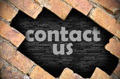 Hole in the brick wall with word contact us - stock photo