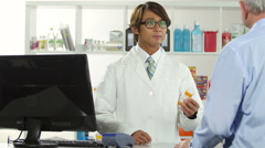 Pharmacist discussing medication with older man - stock footage