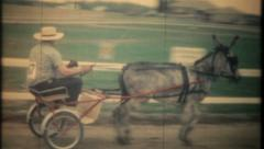 2870 - harness racing with burros at local track - vintage film home movie Stock Footage