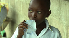 ADEISO BOY STUDENT DRINKS SACHET WATER Stock Footage