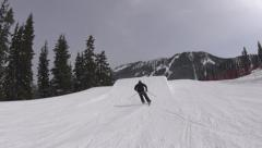 Action Sports: Skier Hitting a Jump and Doing a 360 Follow Cam Stock Footage