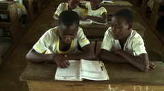 ADEISO CLASSROOM STUDENTS READING Stock Footage