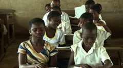 ADEISO CLASSROOM STUDENTS SITTING - stock footage