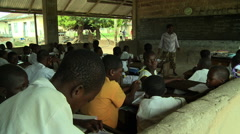 ADEISO CLASSROOM TEACHER READING OUT LOUD - stock footage