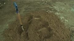 ADEISO PILE OF DIRT WITH SHOVEL Stock Footage