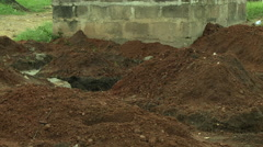ADEISO RAIN ON A PILE OF DIRT - stock footage