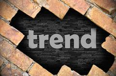 Hole in the brick wall with word trend - stock photo