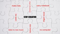 How to Stay Creative? Word Association on white jigsaw puzzle Stock Footage