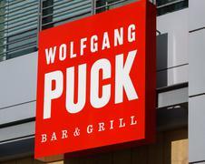Wolfgang Puck Bar and Grill Exterior and Logo Stock Photos