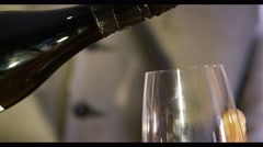 4K Close up of red wine being poured into a glass - stock footage