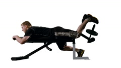 LS Man Doing Leg Curls on Exercise Bench with White Background 4K Stock Footage