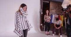 Team of stylists working together on model during fashion photo shoot in - stock footage